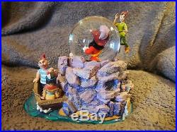 DISNEY'S PETER PAN & CAPTAIN HOOK MUSICAL SNOW GLOBE that plays You Can Fly