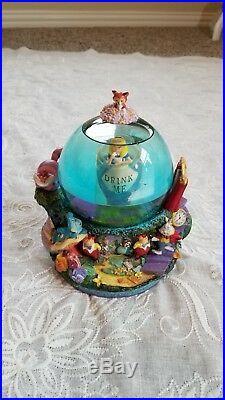 Disney Alice in Wonderland Drink Me Snow Globe All in the Golden blue water