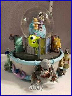Disney Monsters Inc. Musical Monstropolis Snow Globe with Mike Sully & Boo